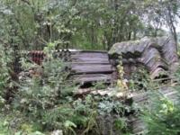 16 Ton asbest in bos gedeponeerd